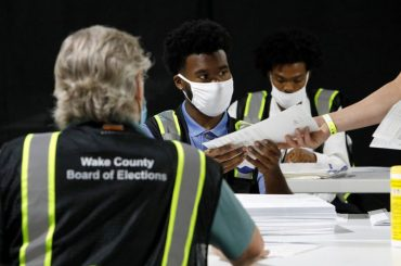 Young U.S. poll workers brace for Election Day as virus fears keep elders home