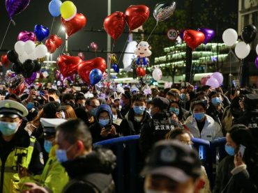 Crowds fill streets in China's pandemic-hit Wuhan, celebrate New Year