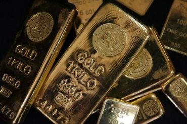 Gold Hits One-Month Low Under $1,850 as Fed Taper Talk Gains Steam
